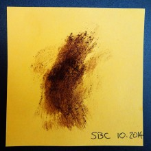 Brown smear on yellow Post-It note.