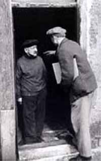Photo of 2 men in doorway