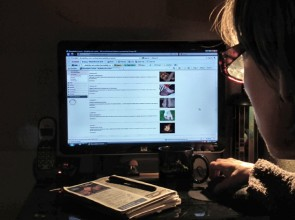 photo of writersitting at a lit computer with her DAO blog on the screen