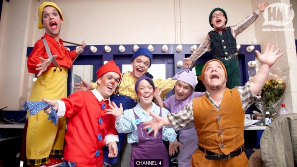 photo of seven people of restricted growth, dressed as dwarves