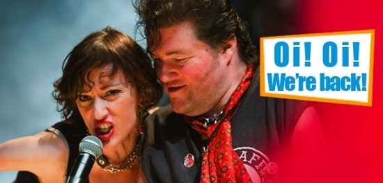 a male and female singers share a mike - next to the slogan 'Oi Oi, We're Back'