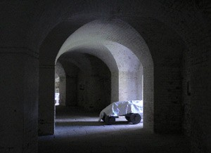 photo shows an interior space in the fort which is dark and has a barrel-vaulted ceiling