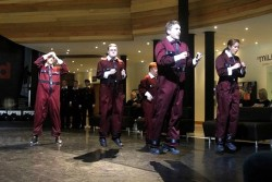 photo of a group of performers in red jump suits