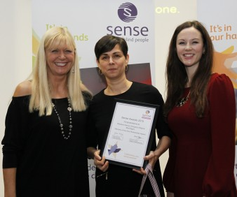 A photograph depicting actress Julie Peasgood presenting Random Dance's Jasmine Wilson and Ellie Douglas-Allan with the award for Art Partnership of the Year