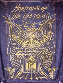 gold design on a blue pair of jeans titled horizons of the unfixed eye