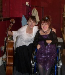 Photograph of Penny Pepper with cello player Jo Cox at a spoken word event at Battersea Arts Centre