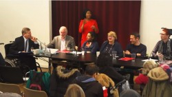 A photograph featuring a panel debate including Richard Rieser, Colin Rogers, Shirani Sabaratnam, Ros Hubbard, Ben Anthony and Ju Gosling, with a signer in the background