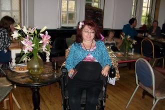 photo female wheelchair-user in a room