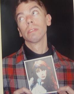 Man holding photo of Kate Bush