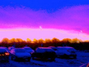 digitised photo of a sunset over a service station