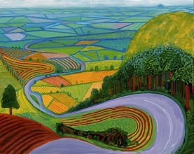 image of a Hockney landscape, looking down a hill at a long, winding road