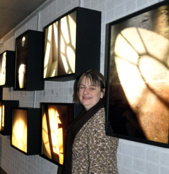 photo of artist standing with lightboxes Photo by Minako Jackson