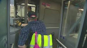 photo of a wheelchair-user getting on a bus