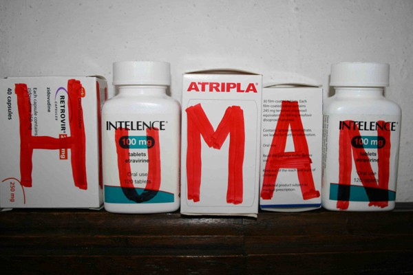 five medication bottles with the word human spelt on each container