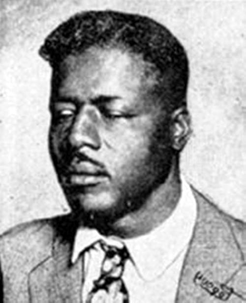 black and white photo of the face of musician Blind Willie Johnson from the cover of Dark Was the Night CD