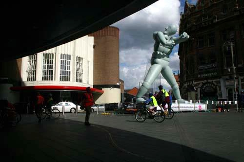 photo of a large inflatable sculpture of a figure with short arms in Leicester city centre