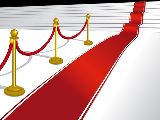 A cartoon image of a red carpet leading up stairs
