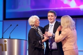 photo of actress Dame Maggie Smith presenting Ryan Kelly with an AMI Award