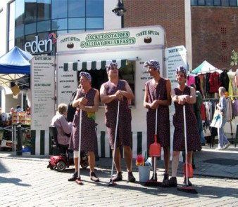 Ana Monro theatre as the cleaning ladies in front of Eden shopping centre