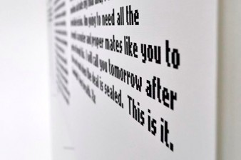 a black and white image of a foam board installation printed with obscured text message