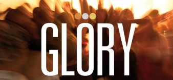 an abstract sepia image with the word GLORY whited-out across it