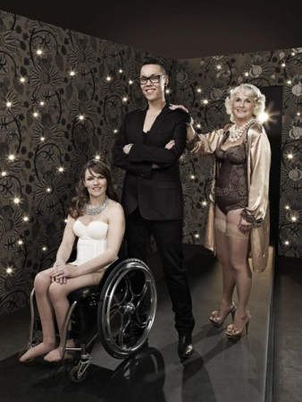 Gok Wan stands with his arms crossed, with two female participants