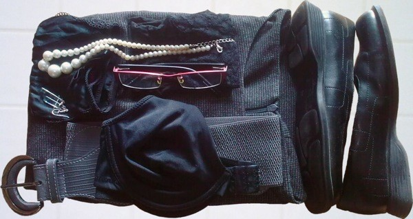 photo of a neatly piled set of black clothes