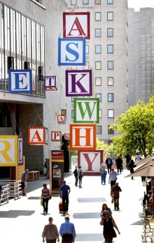 photo of an installation as part of Southbank Centre's Festival of the World. The installation consists of a series of extra large alphabet cubes.