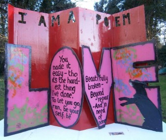 photo of fold-out artwork of the workd 'love' with text on the subject in each letter