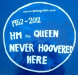 blue plaque reading HM The Queen Never Hoovered Here
