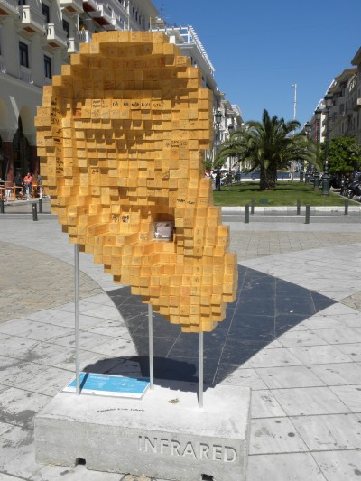 photo of an outdoor sculpture in the shape of a large ear