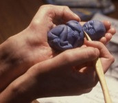 Early Days, Holding Promise  (Blue plasticine) by Nancy Willis