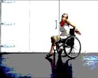 A woman in a wheelchair with head stretched upwards and arms stretched out behind her.