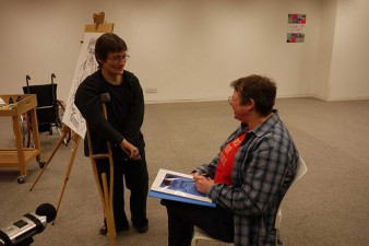 photo of artist and sitter in an art studio